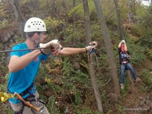 Coming in for a graceful landing on the Vertical Trek at Roundtop Mountain Adventures