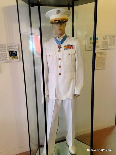 A mannequin at the Eldred World War 2 Museum displays the Medal of Honor and uniform of Mitchell Paige.