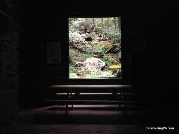 Looking out at Acriggs Falls from inside Bordner Cabin in Swatara State Park.