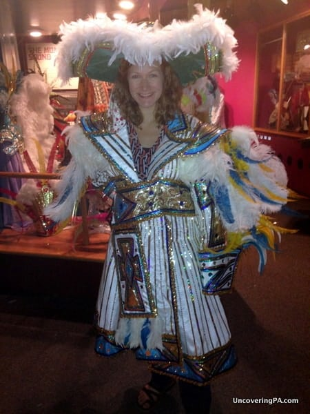 My wife trying on a Mummers' costume while visiting the Mummers Museum in Philadelphia, Pennsylvania.