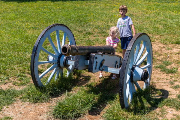 Kids playing with a canon at Valley Forge National Historical Park in Pennsylvania