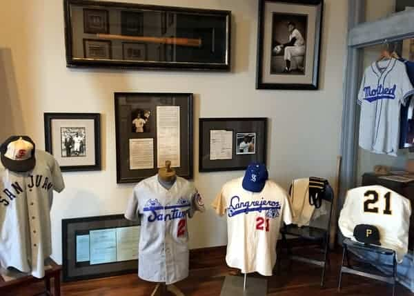 Uniforms, game-used equipment, and photos line the walls of the Roberto Clemente Museum in Pittsburgh, Pennsylvania