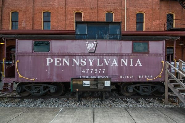 A Pennsylvania Railroad caboose sits outside of the Railroaders Memorial Museum in Altoona, PA.