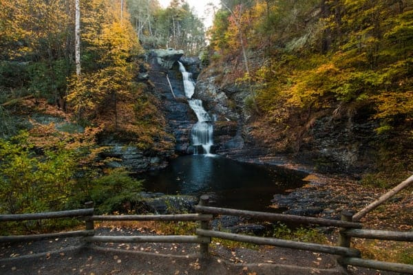 Raymondskill Falls surrounded by fall foliage