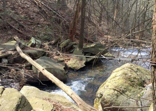 Crossing Jarrett Falls at Meadow Grounds Lake.