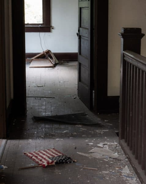 An American flag lies in a hallway at Yellow Dog Village