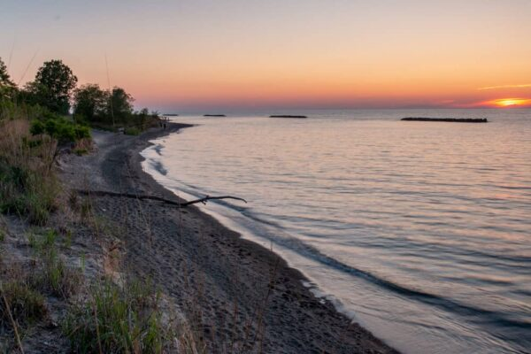 Presque Isle's beaches are a great spot to watch sunset.