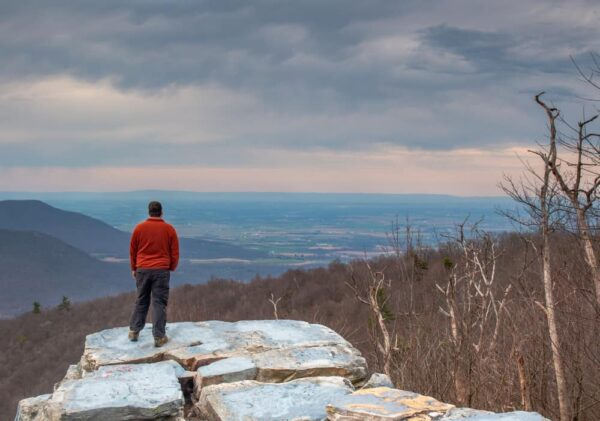 Man standing on Big Mountain Overlook at Tuscarora Mountain in PA