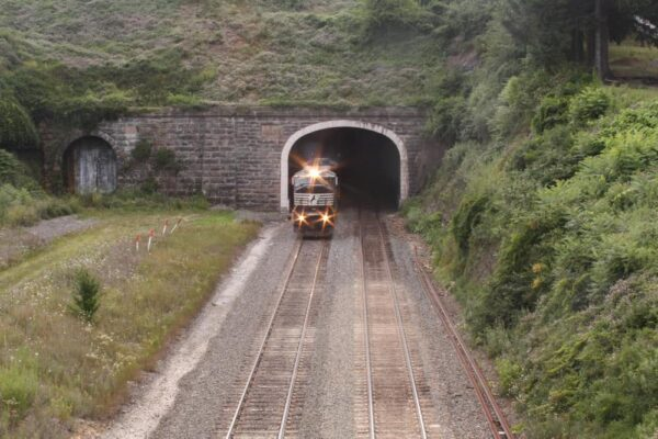 A train emerges from the historic Gallitzin Tunnels in Pennsylvania