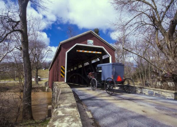 A buggy enters Zook's Mill Covered Bridge in Lancaster County PA