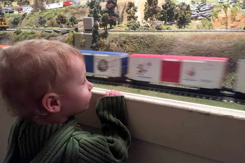 Child watches trains at the Choo Choo Barn in Strasburg PA