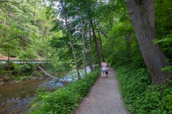 People hiking the Valley Creek Trail in Valley Forge in Pennsylvania