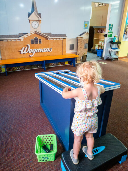 Child playing at the ExpERIEnce Erie Children's Museum
