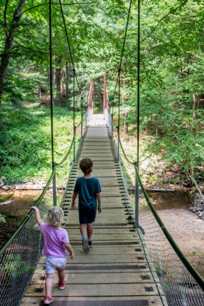 Kids crossing Cook Forest's Swinging Bridge in Pennsylvania