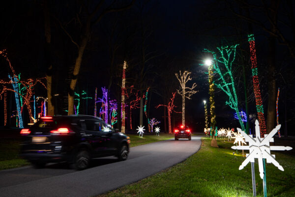 Cars driving through Herr's Christmas Lights in Chester County PA