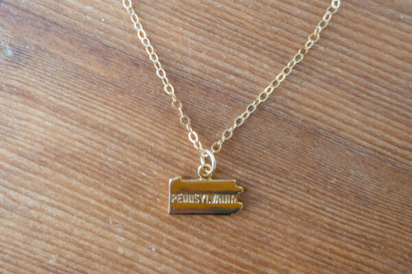"Gold ""Pennsylvania"" stamped necklace"