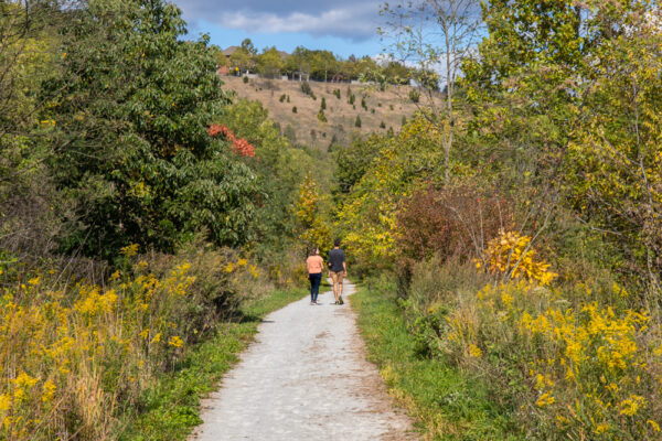 Two people hiking the Nine Mile Run Trail in Pittsburgh's Frick Park