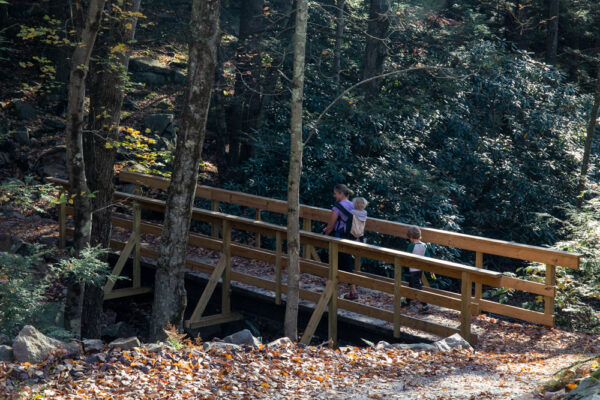 Woman and children hiking the Shades of Death Trail in Hickory Run State Park in the Poconos