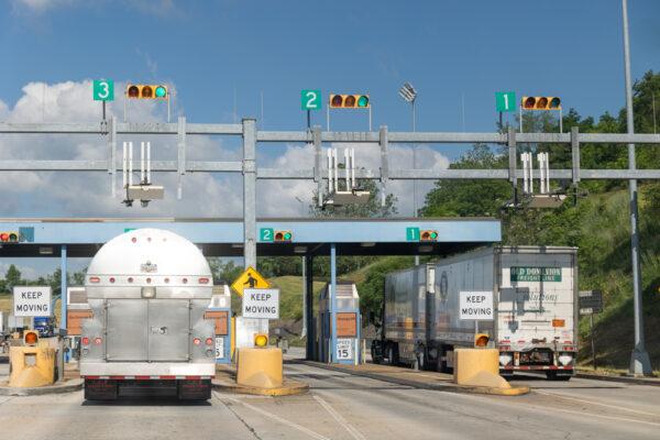Trucks going through a Pennsylvania Turnpike toll booth