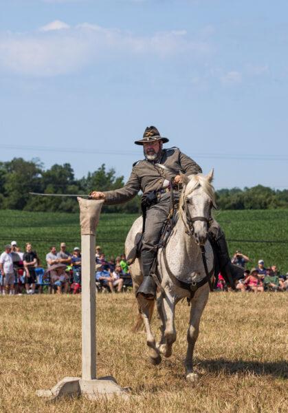 Cavalry reenactor rides at the Gettysburg Reenactment in Pennsylvania