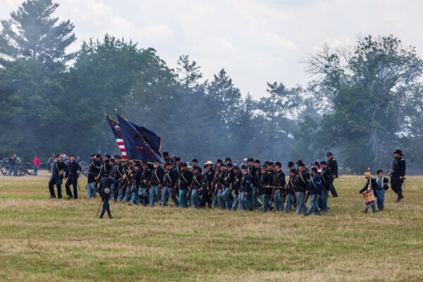 Union Soldiers march onto the field during the Battle of Gettysburg Reenactment in Pennsylvania