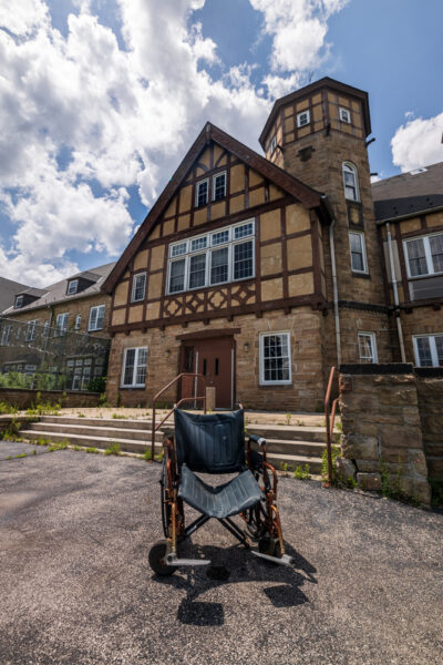 The exterior of the sanatorium building at the abandoned SCI Cresson in the Allegheny Mountains