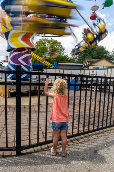 Child watching a ride at Dutch Wonderland in Lancaster County PA