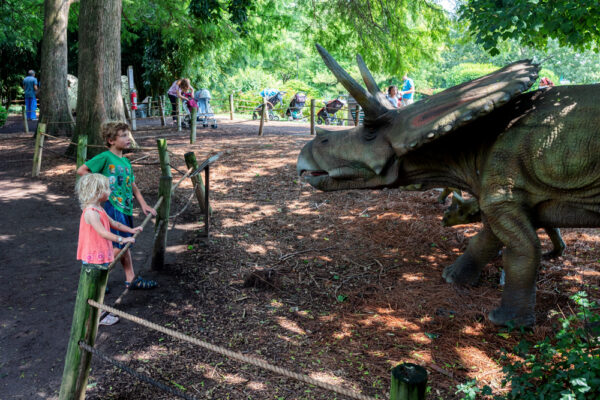 Kids looking at animatronic dinosaurs at Dutch Wonderland In Lancaster County Pennsylvania