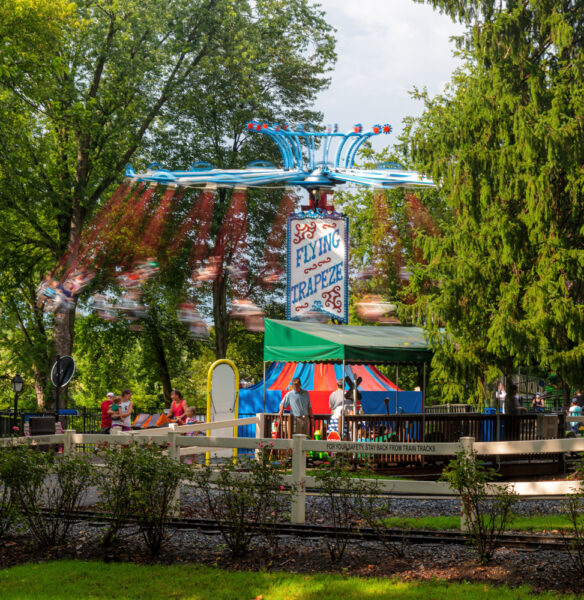 Swings rotating in the forest at Dutch Wonderland in Lancaster PA